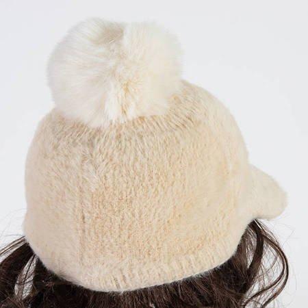 Beige women's cap with a tassel - Caps