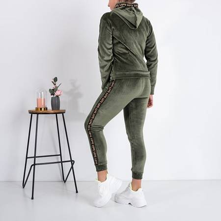 Warm women's green tracksuit set with stripes - Clothing