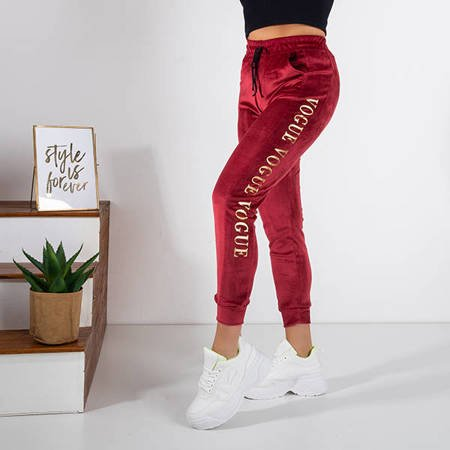 Women's red sweatpants with inscriptions - Clothing
